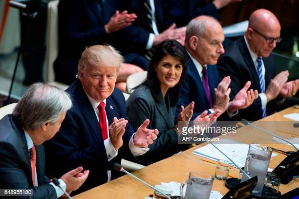 US President Donald Trump US Ambassador to the UN Nikki Haley White House Chief of Staff John Kelly and National Security Advisor H R McMaster clap...