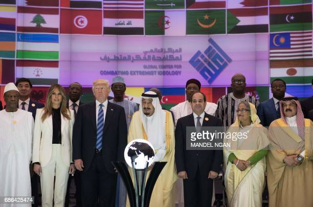 US President Donald Trump US First lady Melania Trump Saudi Arabia's King Salman bin Abdulaziz alSaud and Egypt's President Abdel Fattah elSisi pose...