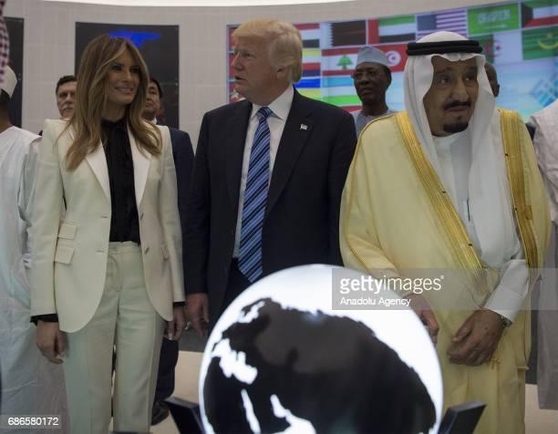 US President Donald Trump US First lady Melania Trump Saudi Arabia's King Salman bin Abdulaziz alSaud listen a briefing during the inauguration...