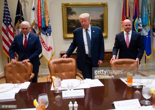 US President Donald Trump US Vice President Mike Pence and National Security Adviser HR McMaster arrive for lunch with members of the US military in...