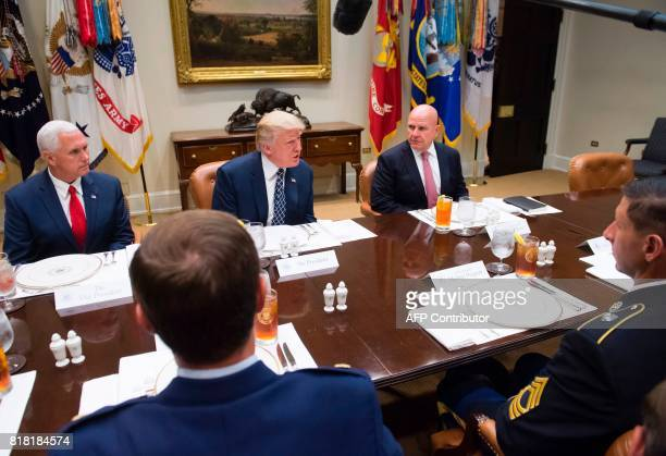 US President Donald Trump US Vice President Mike Pence and National Security Adviser HR McMaster have lunch with members of the US military in the...