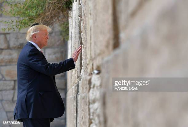 US President Donald Trump visits the Western Wall the holiest site where Jews can pray in Jerusalems Old City on May 22 2017 NGAN