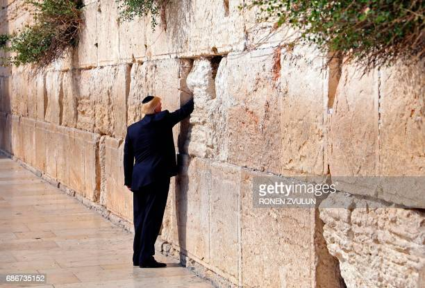 President Donald Trump visits the Western Wall the holiest site where Jews can pray in Jerusalems Old City on May 22 2017 / AFP PHOTO / POOL / RONEN...