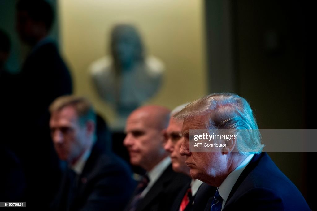 US President Donald Trump waits for a meeting with Prime Minister of Malaysia Najib Razak and others in the Cabinet Room of the White House September 12, 2017 in Washington, DC. / AFP PHOTO / Brendan Smialowski
