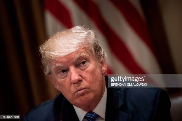 US President Donald Trump waits for a meeting with South Korea's President Moon Jaein and others in the Cabinet Room of the White House June 30 2017...