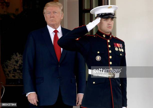S President Donald Trump waits for the arrival of Singapore Prime Minister Lee Hsien Loong at the White House October 23 2017 in Washington DC Trump...