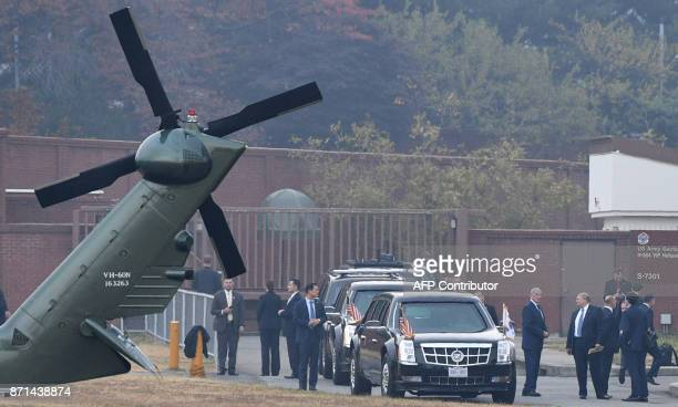 US President Donald Trump waits next to helicopters as US Army Garrison Yongsan in Seoul South Korea on November 8 waiting for bad weather to clear...
