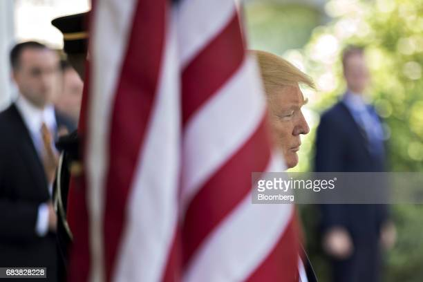 US President Donald Trump waits to greet Recep Tayyip Erdogan Turkey's president not pictured at the West Wing of the White House in Washington DC US...