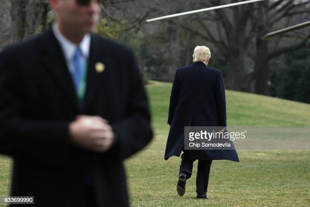S President Donald Trump walks across the South Lawn before boarding Marine One and departing the White House February 3 2017 in Washington DC Trump...