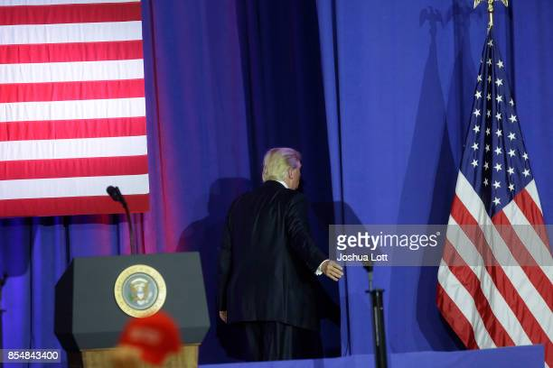 S President Donald Trump walks away from the podium after speaking at the Indiana State Fairgrounds Event Center September 27 2017 in Indianapolis...