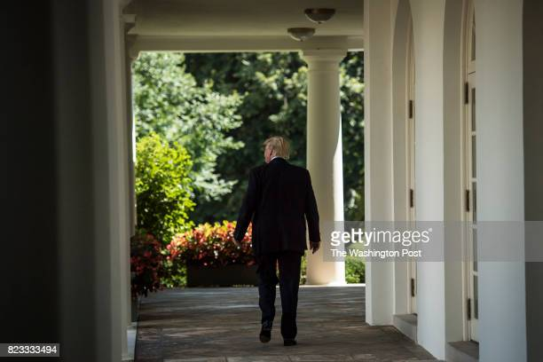 President Donald Trump walks back to the Oval Office after speaking in the Rose Garden during an event with the American Legion Boys Nation and the...