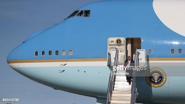 President Donald Trump walks down the stairs after arriving on Air Force One at the Palm Beach International Airport to spend part of the weekend at...