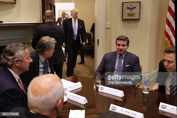 S President Donald Trump walks into the Roosevelt Room for a meeting with Mark Sutton of International Paper Jeff Fettig of Whirlpool White House...
