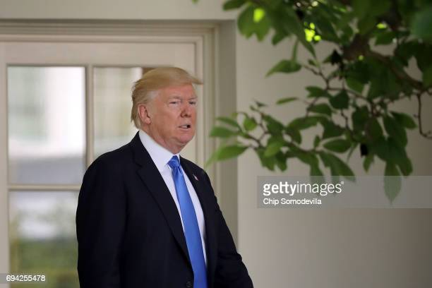 S President Donald Trump walks into the Rose Garden for a news conference with President Klaus Iohannis of Romania at the White House June 9 2017 in...