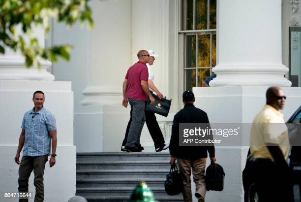 US President Donald Trump walks into the White House after returning from the Trump National Golf Club on October 21 2017 in Washington DC / AFP...
