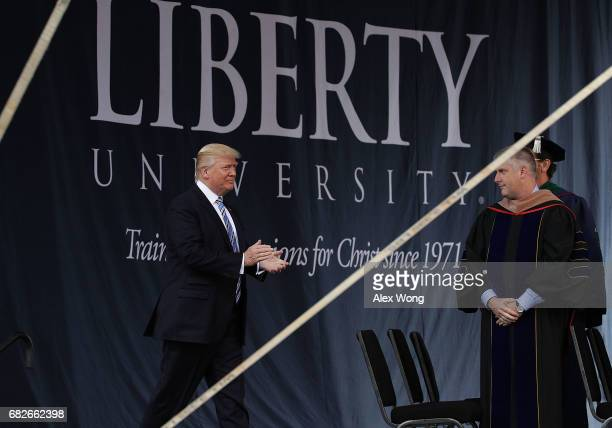 S President Donald Trump walks on stage during the commencement at Liberty University May 13 2017 in Lynchburg Virginia President Trump is the first...
