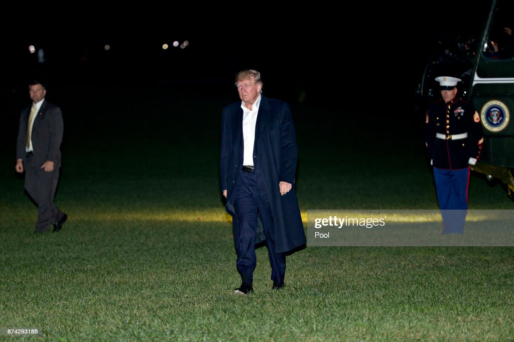 U.S. President Donald Trump walks on the South Lawn of the White House after returning from an 11-day Asia trip November 14, 2017 in Washington, D.C. Trump declared his 11-day swing through Asia a success before heading home today saying 'all countries dealing with us on trade know that the rules have changed.' Photo by Andrew Harrer-Pool/Getty Images)