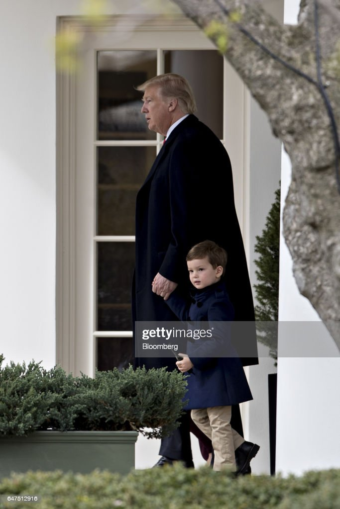 U.S. President Donald Trump walks out of the Oval Office of the White House towards Marine One with his grandchild Joseph Kushner in Washington, D.C., U.S., on Friday, March 3, 2017. Trump is traveling to Florida to participate in a tour of Saint Andrew Catholic School and attend the RNC Spring Retreat dinner. Photographer: Andrew Harrer/Bloomberg via Getty Images