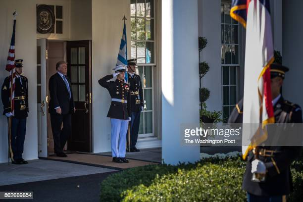President Donald Trump walks out of the West Wing for the arrival of the Greek Prime Minster Alexis Tsipras to the White House on Tuesday Oct 17 in...