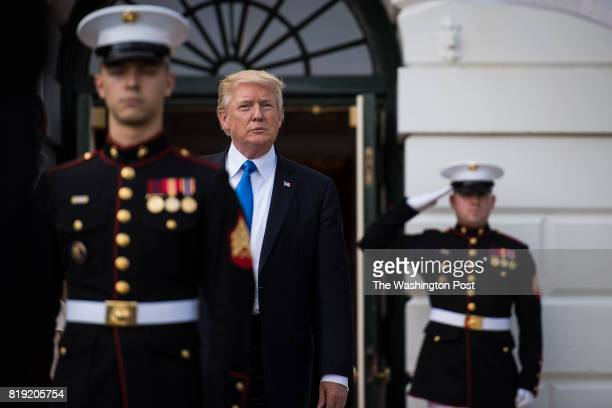President Donald Trump walks out to receive South Korean President Moon Jaein and his wife Kim Jeongsuk at the South Portico of the White House in...