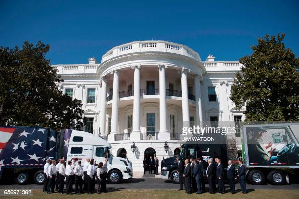 US President Donald Trump walks out to welcome truckers and CEOs to the White House in Washington DC March 23 to discuss healthcare / AFP PHOTO / JIM...