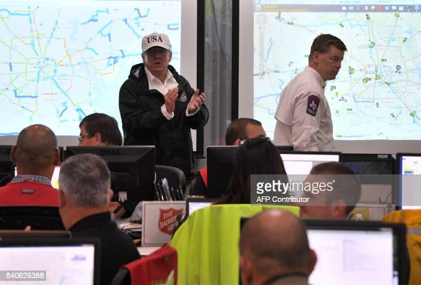 US President Donald Trump walks through the the Texas Department of Public Safety Emergency Operations Center in Austin Texas on August 29 as rains...