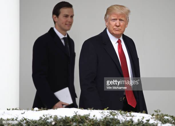 S President Donald Trump walks to a waiting Marine One helicopter with soninlaw and senior advisor Jared Kushner while departing the White House on...