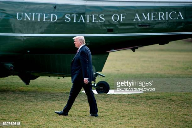 President Donald Trump walks to Marine One for his first trip to Philadelphia as President on the South Lawn of the White House January 26 2017 in...