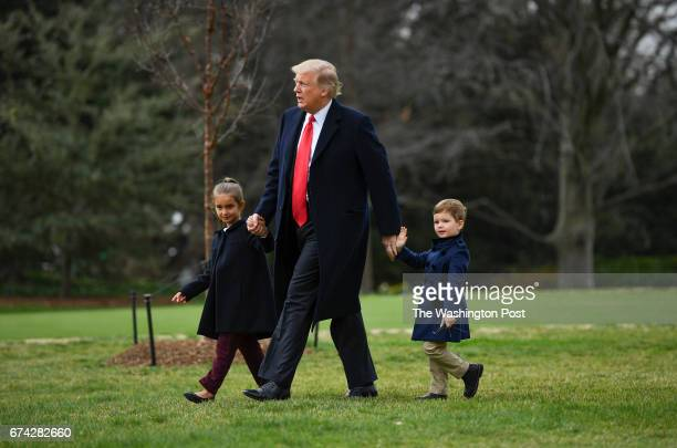 President Donald Trump walks to Marine One on the South Lawn of The White House with his grandchildren Joseph and Arabella Kushner before departing...