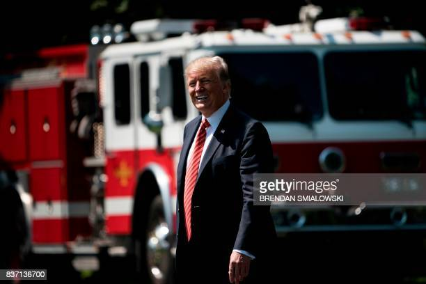 US President Donald Trump walks to Marine One on the South Lawn of the White House August 22 2017 in Washington DC en route to Yuma Arizona / AFP...