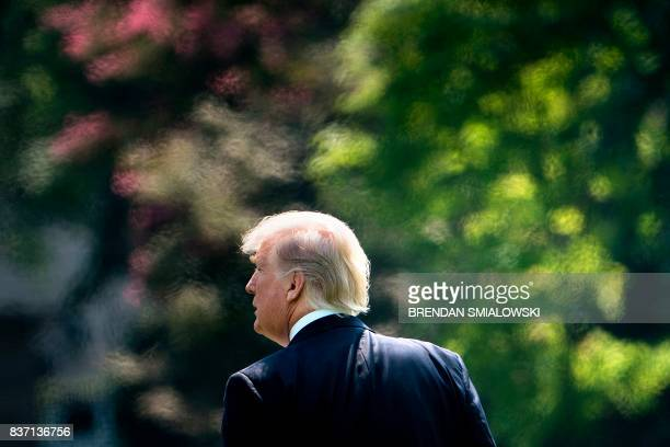 President Donald Trump walks to Marine One on the South Lawn of the White House August 22 2017 in Washington DC en route to Yuma Arizona / AFP PHOTO...