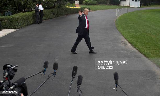 President Donald Trump walks to Marine One prior to departing from the South Lawn of the White House in Washington DC on October 11 as he travels to...