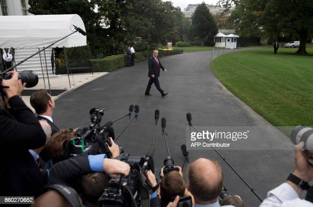 US President Donald Trump walks to Marine One prior to departing from the South Lawn of the White House in Washington DC on October 11 as he travels...