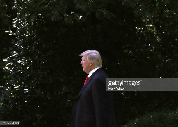 S President Donald Trump walks to Marine One while departing from the White House on July 24 2017 in Washington DC President Trump is traveling to...