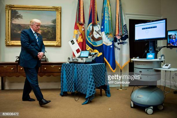 US President Donald Trump walks toward medical equipment after speaking about new technology used by the Department of Veterans Affairs during an...