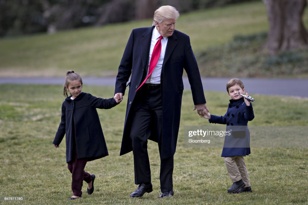 U.S. President Donald Trump walks towards Marine One on the South Lawn of the White House with his grandchildren Arabella Kushner, left, and Joseph Kushner in Washington, D.C., U.S., on Friday, March 3, 2017. Trump is traveling to Florida to participate in a tour of Saint Andrew Catholic School and attend the RNC Spring Retreat dinner. Photographer: Andrew Harrer/Bloomberg via Getty Images