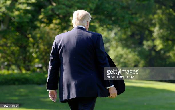 US President Donald Trump walks towards Marine One while departing the White House on May 17 2017 in Washington DC en route to Connecticut / AFP...
