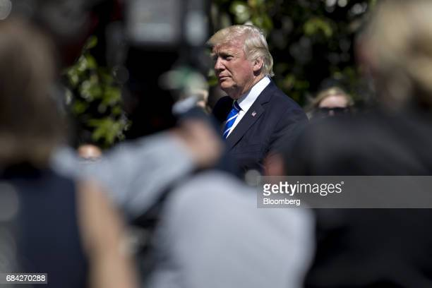 US President Donald Trump walks towards the White House after arriving on Marine One in Washington DC US on Wednesday May 17 2017 Republican leaders...