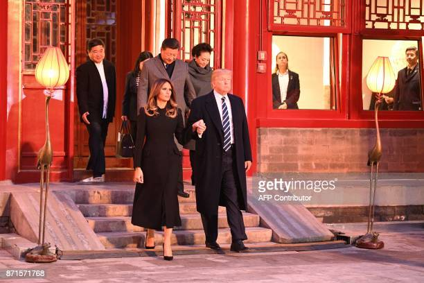 US President Donald Trump walks with First Lady Melania Trump as they tour the Forbidden City with China's President Xi Jinping and his wife Peng...