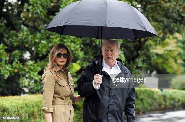 US President Donald Trump walks with first lady Melania Trump prior to their Marine One departure from the White House September 2 2017 in Washington...