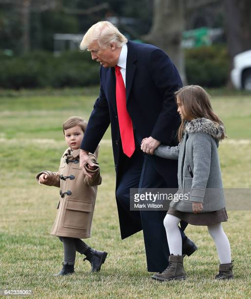 S President Donald Trump walks with his grandchildren Arabella and Joseph Kushner toward Marine One while departing from the White House on February...