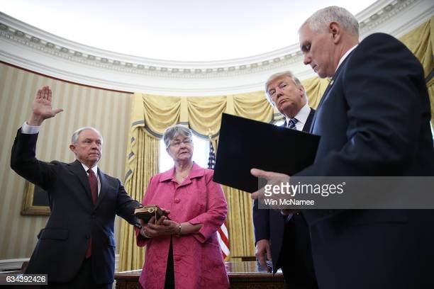 S President Donald Trump watches as Jeff Sessions is swornin as the new US Attorney General by US Vice President Mike Pence in the Oval Office of the...