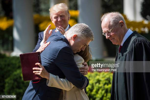 President Donald Trump watches as Supreme Court Justice Neil Gorsuch hugs his wife Marie Louise moments after Supreme Court Justice Anthony Kennedy...