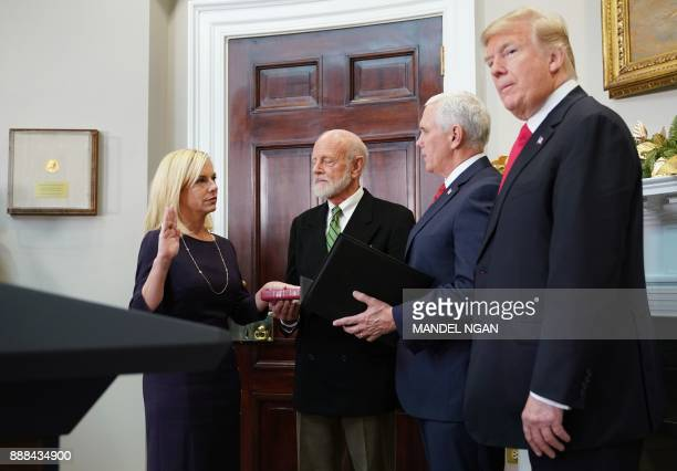 US President Donald Trump watches as Vice President Mike Pence administers the oath of office to Homeland Security Secretary Kirstjen Nielsen in the...