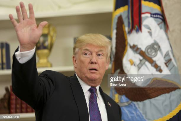 US President Donald Trump waves after an event honoring World War II veteran Native American 'Code Talkers' inside the Oval Officer of the White...