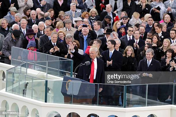 S President Donald Trump waves after delivering his inaugural address on the West Front of the US Capitol on January 20 2017 in Washington DC In...