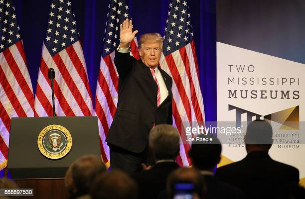 President Donald Trump waves after speaking following a tour of the Mississippi Civil Rights Museum on December 9 2017 in Jackson Mississippi The...