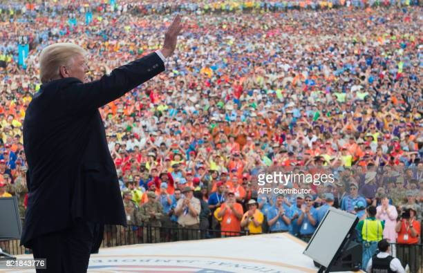 US President Donald Trump waves after speaking to Boy Scouts during the National Boy Scout Jamboree at Summit Bechtel National Scout Reserve in Glen...