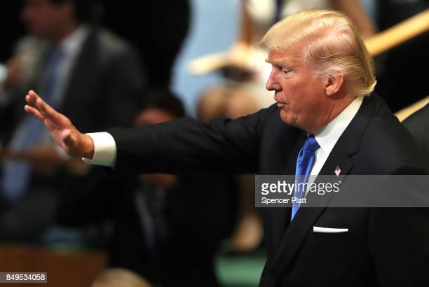 President Donald Trump waves after speaking to world leaders at the 72nd United Nations General Assembly at UN headquarters in New York on September...