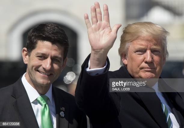 US President Donald Trump waves alongside Speaker of the House Paul Ryan as Trump leaves the Friends of Ireland Luncheon for the visit of Taoiseach...
